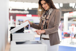 Smiling woman making copies in office