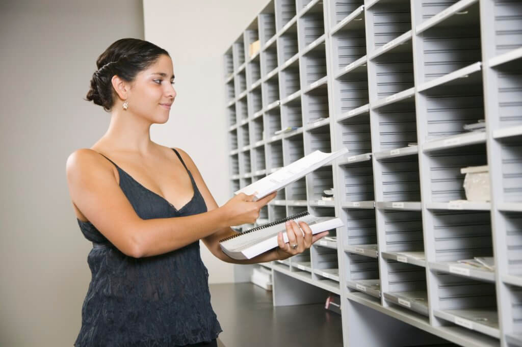 Businesswoman sorting mail